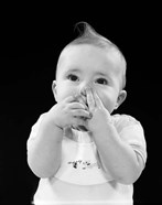 1950s Baby Covering Mouth With Hands