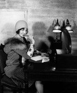 1920s  Woman With Pen To Lips Wearing Cloche Hat