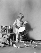 1930s Boy Beating On Toy Drum