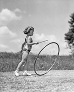 1930s Girl Outdoors Playing Hoop And Stick Game