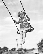 1930s 1940s Smiling Girl On Swing Outdoor