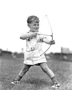 1930s Boy Outdoors Aiming Toy Bow And Arrow Archery
