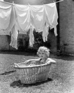 1930s 1940s Girl Outdoors Sitting In Laundry Basket