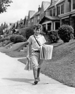 1930s Newsboy Delivering Newspapers