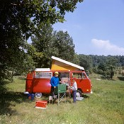 1970s Father And Son Cooking At Campsite