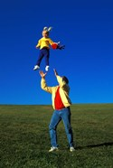 1990S Father Tossing Daughter Up In The Air