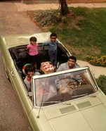 1970s African American Family Seated In Convertible Car